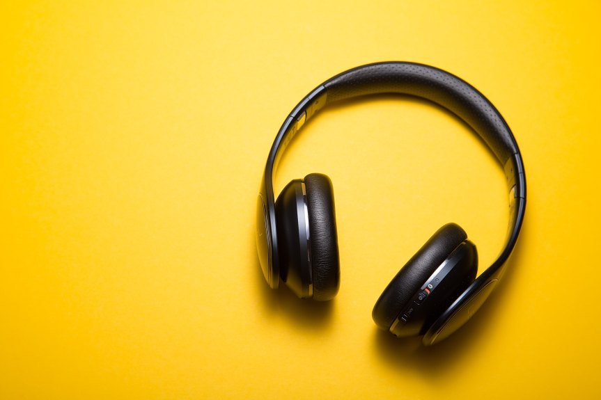 Black headphones on a bright yellow background